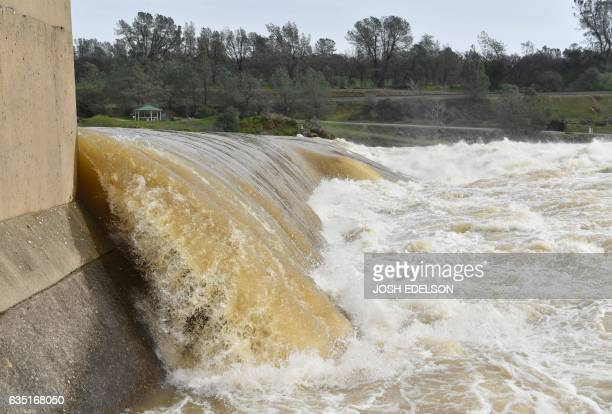Water rushes at the Feather River Fish Hatchery in Oroville California on February 13 2017 Almost 200000 people were under evacuation orders in...