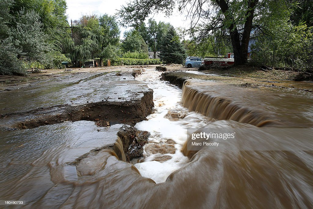 Water rushes down a flooded Topaz Street September 13, 2013 in Boulder, Colorado. Heavy rains for the better part of week has fueled widespread flooding and evacuations in numerous Colorado towns, with the area reportedly already having received 15 inches of rain. Photo by Marc Piscotty/Getty Images)