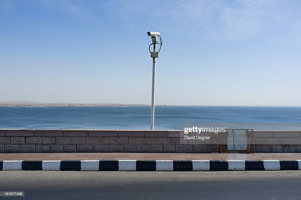 Water security is a major issue in the future of Egypt. A security camera watches the high damn with Lake Nasr backed up behind it, March 15, 2012.