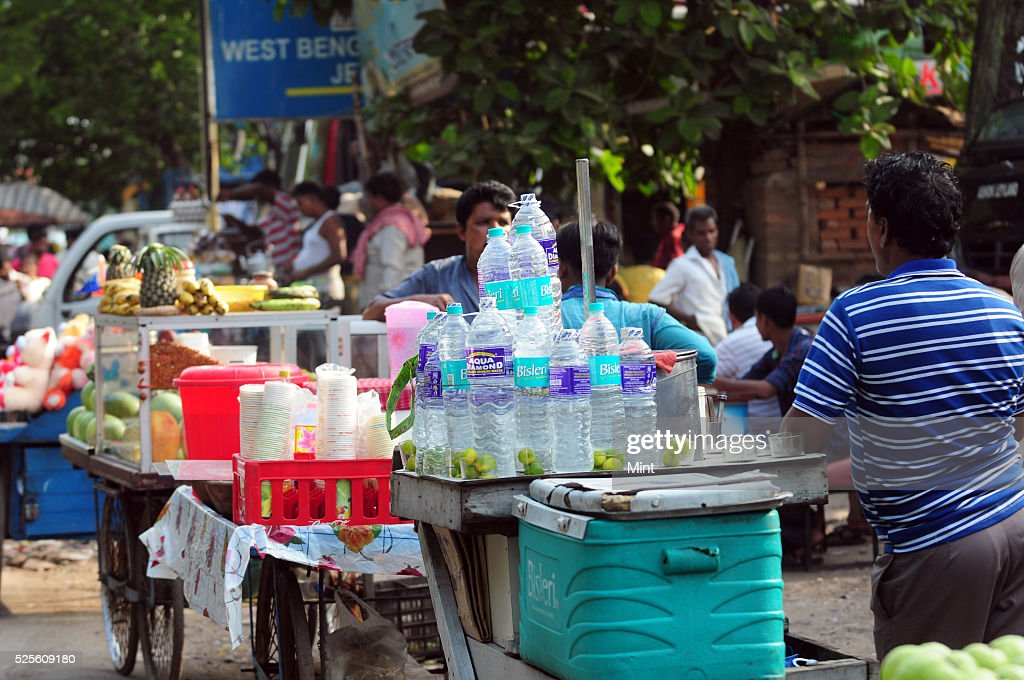 Water sellers, Juice and sugar cane sellers doing good business because of hot summer on May 28, 2015 in Kolkata, India.