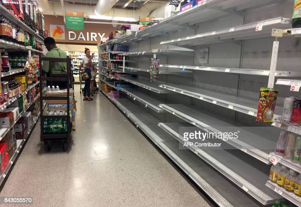 Water shelves are empty in a supermarket in Miami Beach where people are scrambling to buy provisions on September 5 2017 Tourists in Key West are...