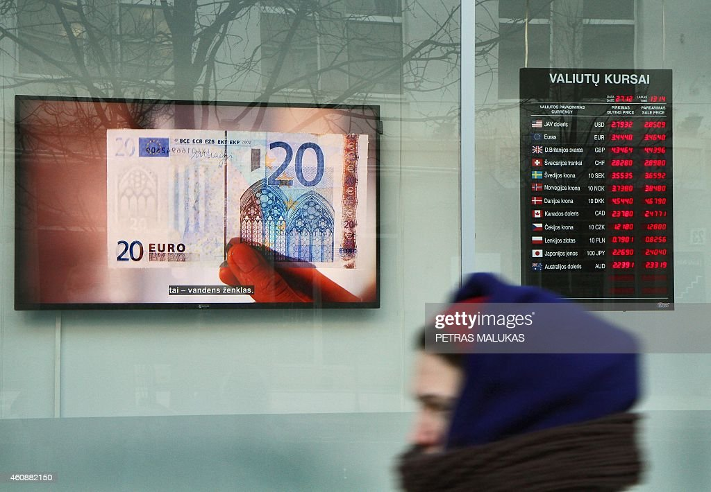 A water sign of a bank note is screened in a shop window of a bank in Vilnius on December 27 as Lithuania will adopt the Euro on January 1 2015...