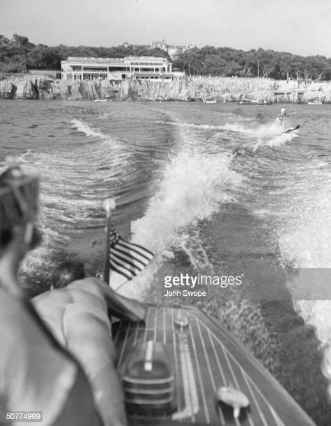 Water skiing enthusiast Sonja Heine takes turn behind a peedboat in front of Eden Roc