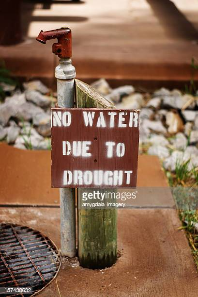 water spigot drought warning sign
