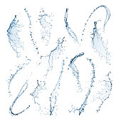 Different shaped water splashes are twisting and curving in different directions. The mid air shapes are isolated on a white background with clipping paths. The water is blue and transparent with drop