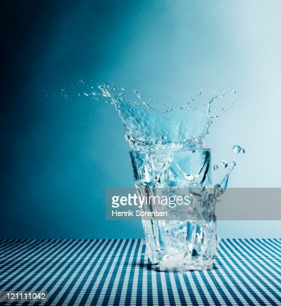 Water splashing from broken glass : Stock Photo