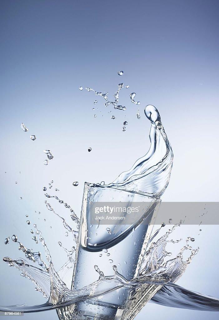 Water splashing in glass : Stock Photo