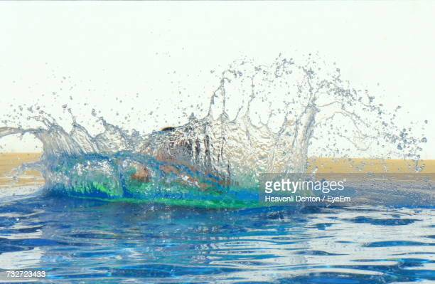 Water Splashing In Sea Against Sky