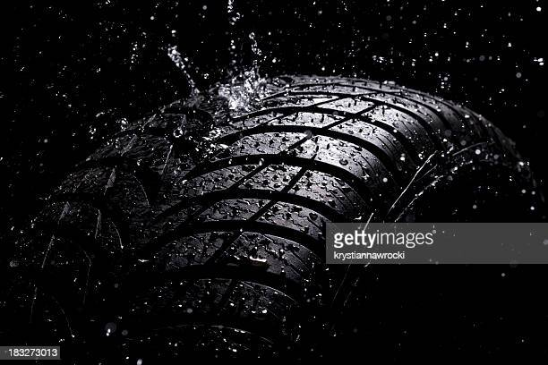 Water splashing on a new tire during the rain