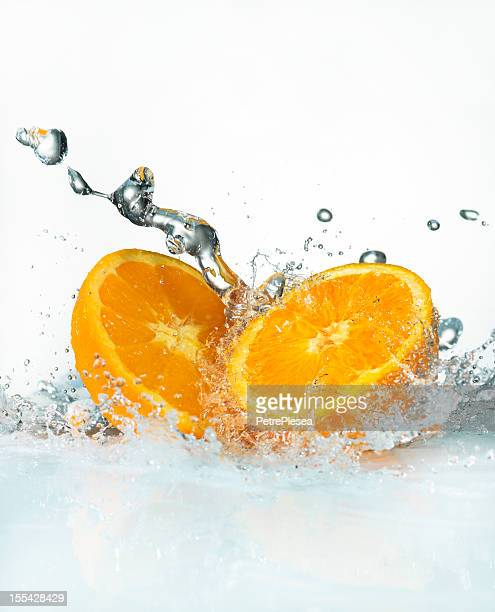 Water Splashing on Fresh Oranges