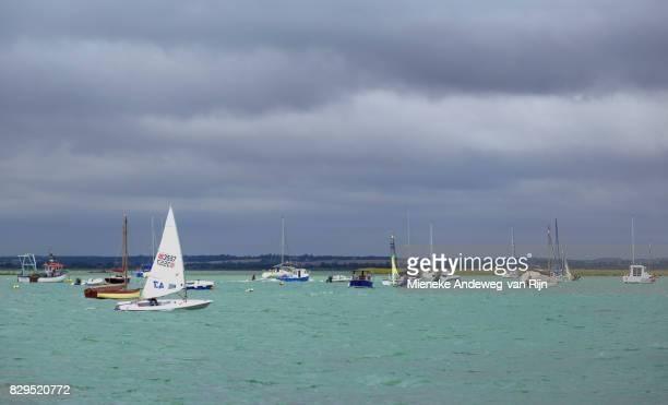 Water sports activities at West Mersea under threatening skies, Essex, England, United Kingdom.