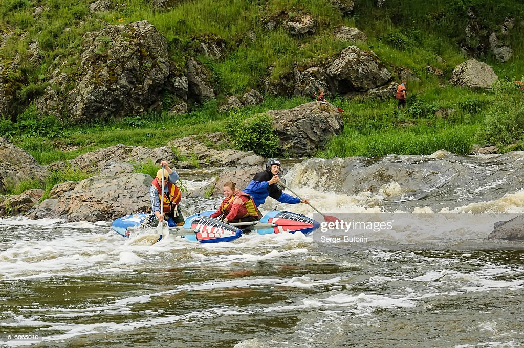Water sportsmen move in threshold : Stock Photo