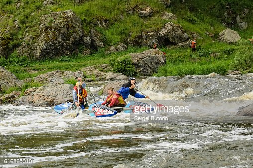 Water sportsmen move in threshold : Stock Photo