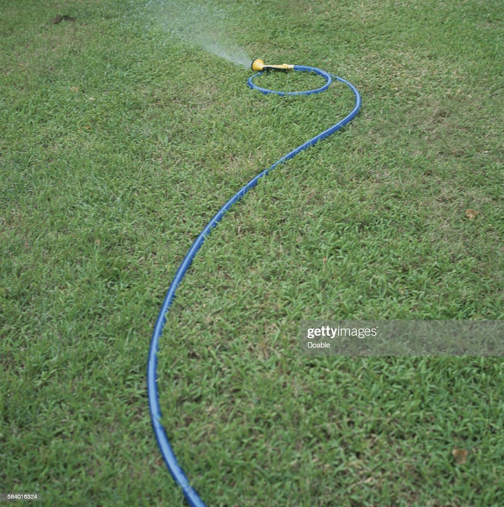 Water spraying from garden hose saipan stock photo getty