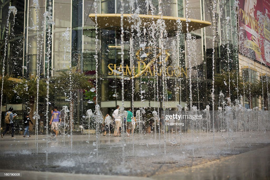 Water sprays from a fountain outside the Siam Paragon shopping mall in Bangkok, Thailand, on Tuesday, Feb. 5, 2013. Thai inflation may average 2.8 percent this year, the Bank of Thailand said. Photographer: Brent Lewin/Bloomberg via Getty Images