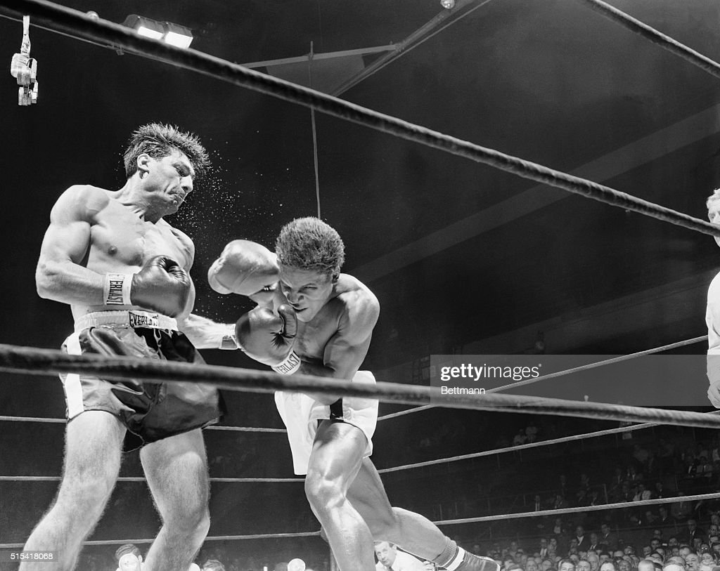 Water sprays from the head of Eduardo Lausse as he lands a hard left to the body of Milo Savage Salt Lake City middleweight during the fourth round...