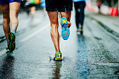 water sprays from under running shoes runner men
