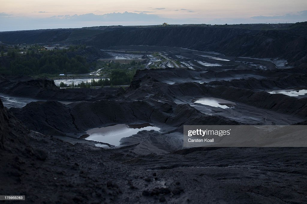 Water stands in the Welzow open-pit lignite coal mine on August 10, 2013 near Welzow, Germany. The mine, operated by Vattenfall, is one of several in the immediate area that feed a nearby power plant with coal. In a development project initiated by state government, other nearby former open-pit mines have been turned into lakes in a rejuvenation effort that is also intended to make the area a viable tourist destination.
