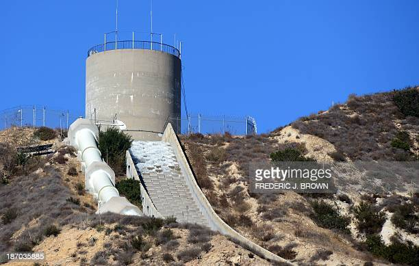 Water starts to flow down during a reenactment of the moment the Los Angeles Aqueduct gates were first opened 100 years ago on November 5 2013 in...