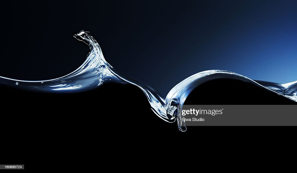 Water surface, water wave on black background : Stock Photo