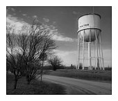 Water Tank By Dirt Road