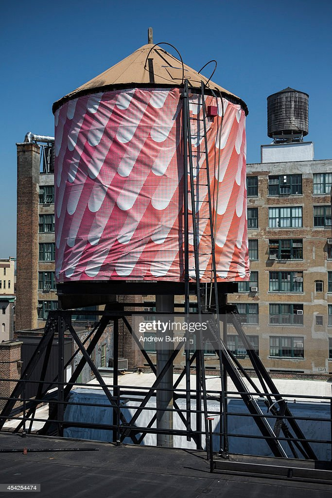 A water tank, reimagined and wrapped as an artistic canvas by artist Sigrid Calon and sponsored by Swatch for The Water Tank Project, is seen at 530 West 25th Street on August 27, 2014 in the Chelsea neighorhood of New York City. The Water Tank Project will wrap over 100 water tanks around New York City with art by both new and established artists through the end of October 2014. The goal of the project is to raise awareness about water usage and the environment.