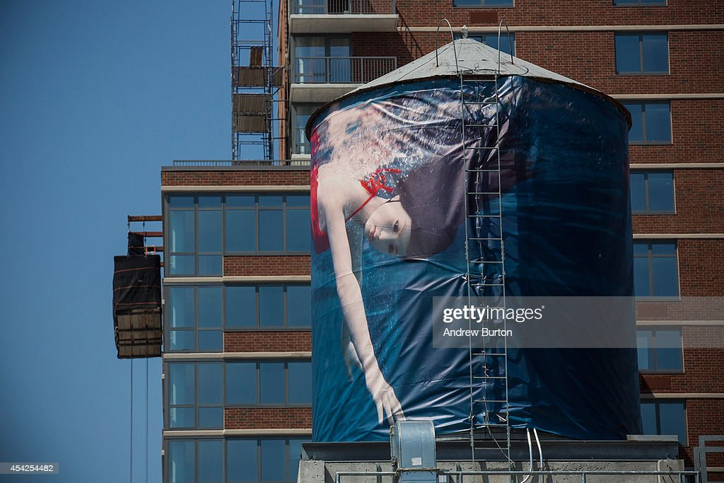 A water tank, reimagined and wrapped as an artistic canvas by artist Laurie Simmons for The Water Tank Project, is seen at 525 West 28th Street on August 27, 2014 in the Chelsea neighorhood of New York City. The Water Tank Project will wrap over 100 water tanks around New York City with art by both new and established artists through the end of October 2014. The goal of the project is to raise awareness about water usage and the environment.