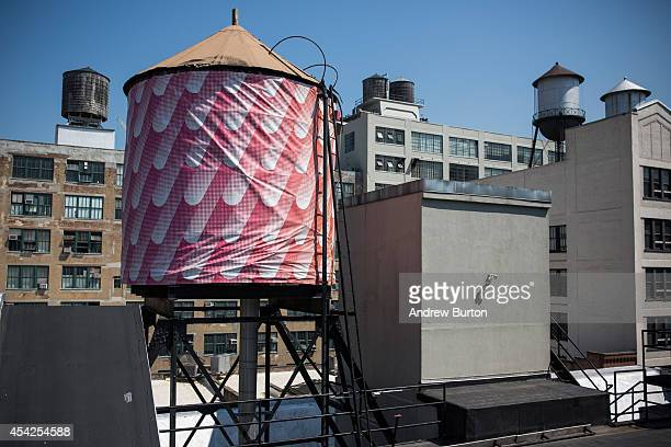 A water tank reimagined and wrapped as an artistic canvas by artist Sigrid Calon and sponsored by Swatch for The Water Tank Project is seen at 530...