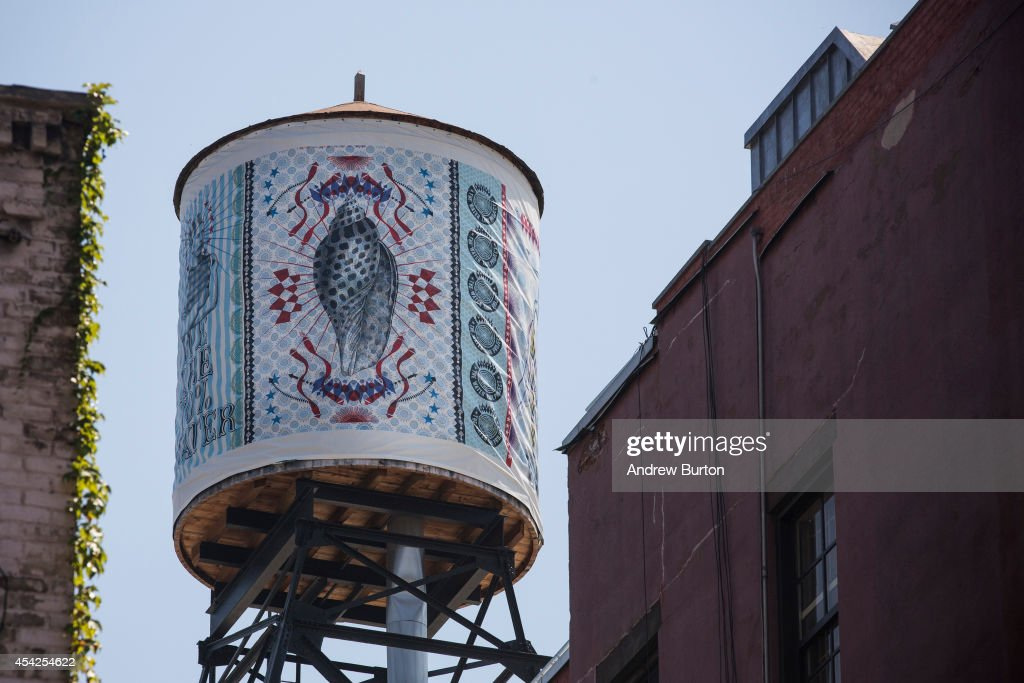 A water tank, reimagined and wrapped as an artistic canvas by artist Lorenzo Petrantoni for The Water Tank Project, is seen at 393 West Broadway on August 27, 2014 in the SoHo neighorhood of New York City. The Water Tank Project will wrap over 100 water tanks around New York City with art by both new and established artists through the end of October 2014. The goal of the project is to raise awareness about water usage and the environment.