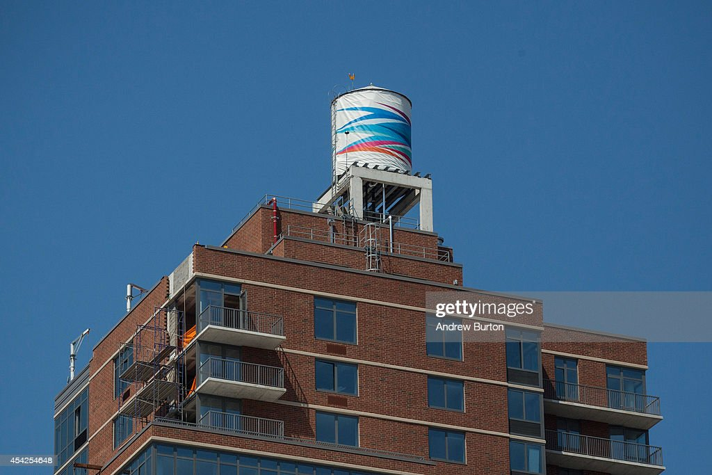 A water tank, reimagined and wrapped as an artistic canvas by artist Odili Donald Odita for The Water Tank Project, is seen at 282 11th Avenue on August 27, 2014 in the Chelsea neighorhood of New York City. The Water Tank Project will wrap over 100 water tanks around New York City with art by both new and established artists through the end of October 2014. The goal of the project is to raise awareness about water usage and the environment.