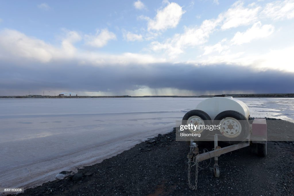 A water tank sits on the edge of a salt lake near the St Ives Gold Mine operated by Gold Fields Ltd. in Kambalda, Australia, on Wednesday, Aug. 9, 2017. Global gold deals have also slowed, declining to $19.8 billion in 2016 from $22.8 billion a year earlier, according to data complied by Bloomberg.Photographer: Carla Gottgens/Bloomberg via Getty Images