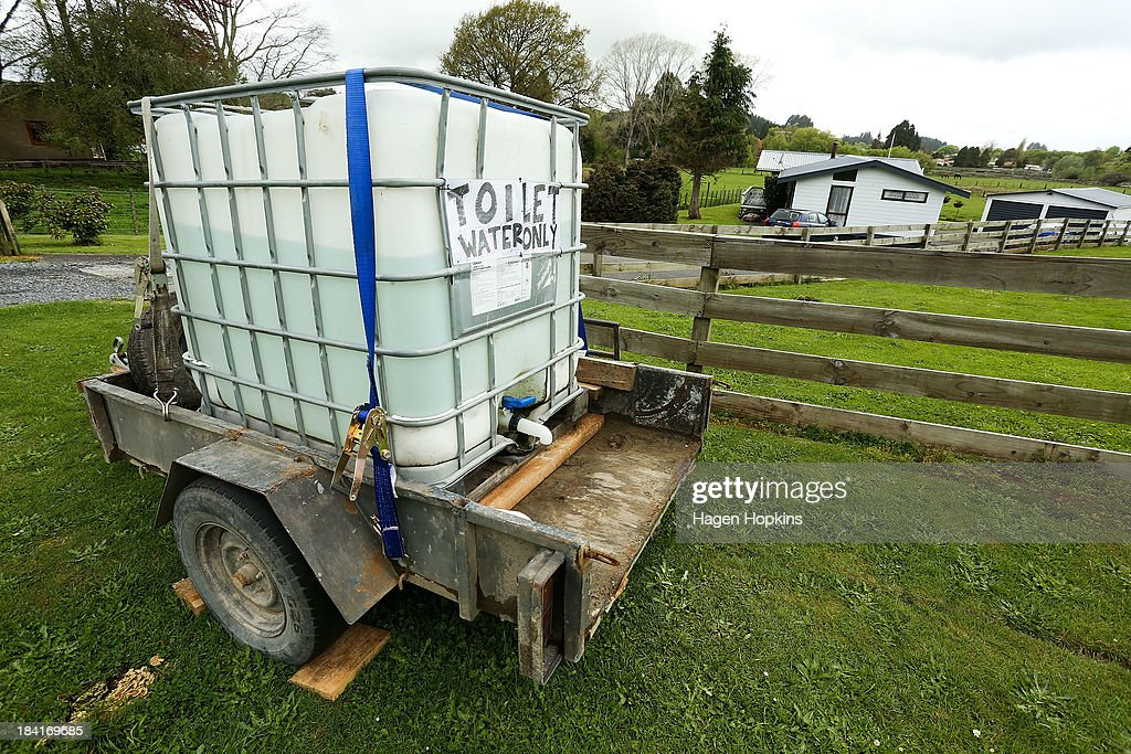 A water tank sits outside a house on October 12, 2013 in Raetihi, New Zealand. Work has begun to flush a stream contaminated by a large diesel spill at Tongariro National Park. A tank from the Turoa Ski Field has leaked 15,000 litres of diesel into the Makotuku stream.