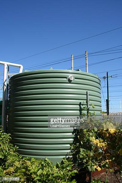 A water tank surrounded by a floral vine