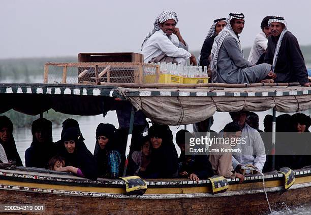 A water taxi carries Marsh Arabs in the AlHawizeh marshlands near the Iranian border May 1979 in Iraq