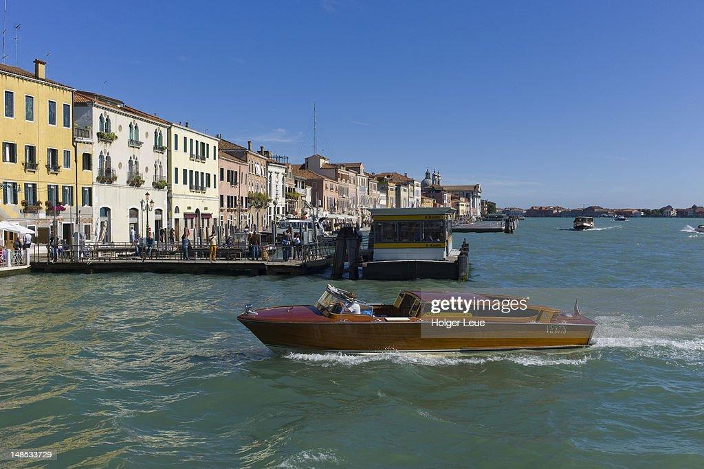 Water taxi on Canale della Guidecca with San Basilio Vaporetto stop.
