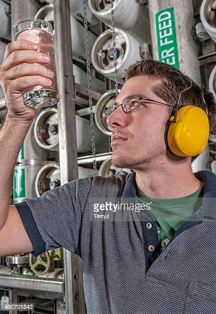 Water Technician Holds Up a Clean Glass of Water