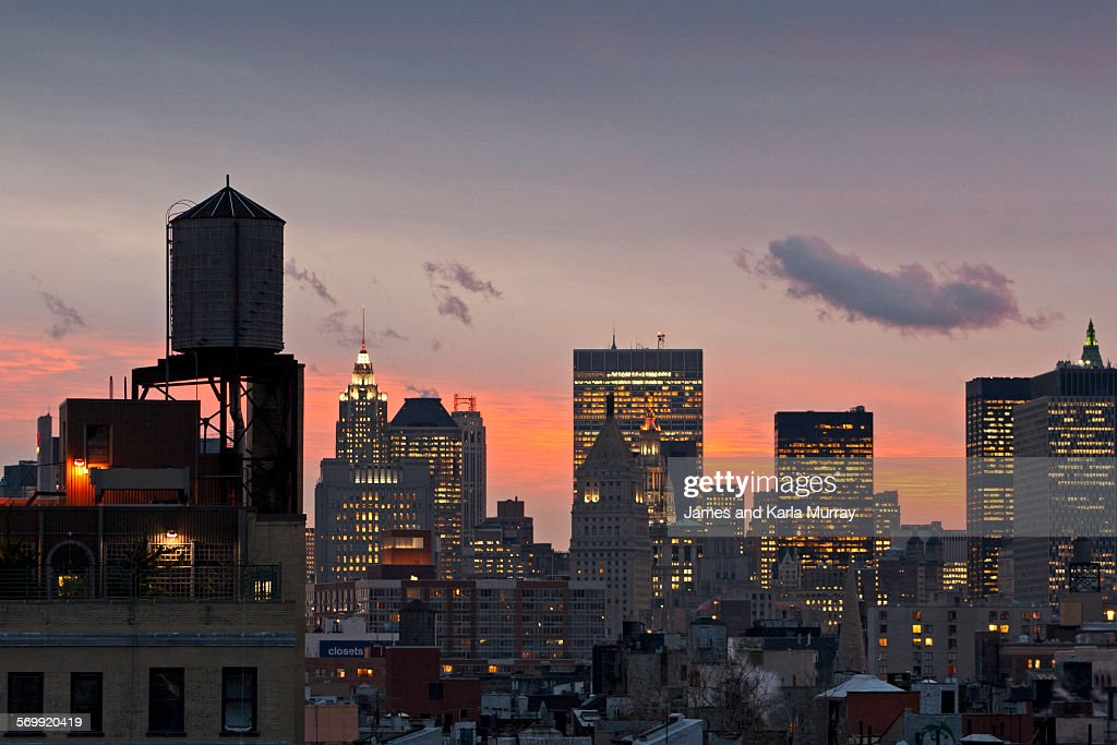 Water tower and lower Manhattan Skyline at sunset