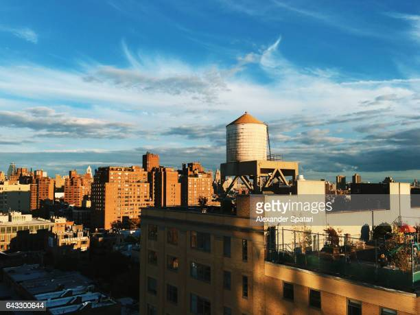 Water tower on the roof of a building in Chelsea district, New York