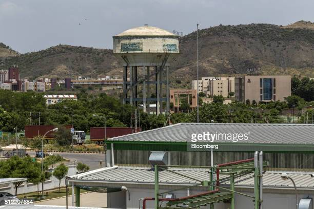 A water tower stands amid commercial buildings inside the Rajasthan State Industrial Development and Investment Corporation's industrial complex in...