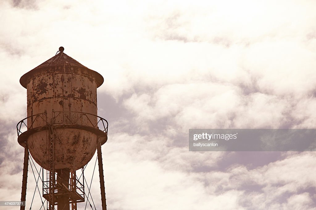 Water tower with sky in the background