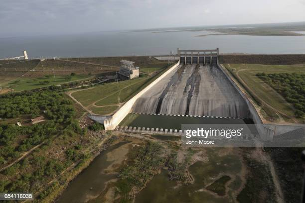 Water trickes through water gates on the Falcon Dam on the Rio Grande at the USMexico border on March 16 2017 in Starr County Texas The dam was was...