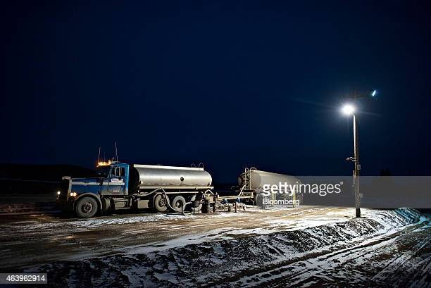 A water truck sits at a saltwater disposal site near Sidney Montana US on Saturday Feb 14 2015 A plunge in global energy prices that has put some...