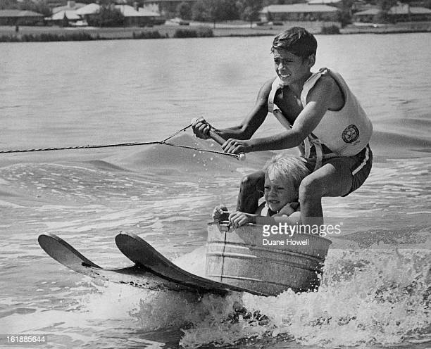 AUG 10 1972 AUG 12 1972 AUG 13 1972 Water Tubbing Makes Appearance In Denver These Denver boys combine a washtub and a pair of water skis for some is...