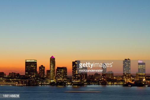 Water view of the Hoboken New Jersey skyline at dusk
