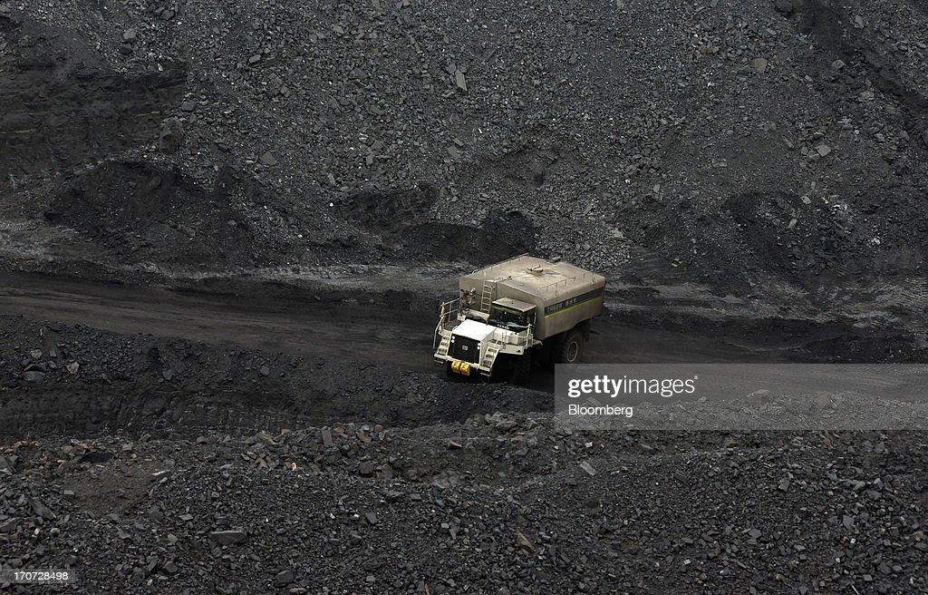 A water wagon drives at the open pit in the Tsankhi section of the Tavan Tolgoi coal deposit, developed by Erdenes Tavan Tolgoi LLC, in South Gobi, Mongolia, on Wednesday, June 5, 2013. Mongolia, a country of almost 2.9 million people, has some of the world's biggest undeveloped mineral reserves, including Oyu Tolgoi, a copper and gold mine, and Tavan Tolgoi, a coal deposit. Photographer: Tomohiro Ohsumi/Bloomberg via Getty Images