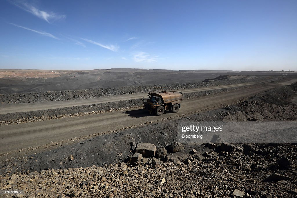 A water wagon drives at the open pit in Ukhaa Khudag section of the Tavan Tolgoi coal deposit, developed by Energy Resources LLC, in South Gobi, Mongolia, on Thursday, June 6, 2013. Mongolia, a country of almost 2.9 million people, has some of the world's biggest undeveloped mineral reserves, including Oyu Tolgoi, a copper and gold mine, and Tavan Tolgoi, a coal deposit. Photographer: Tomohiro Ohsumi/Bloomberg via Getty Images
