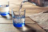 Glasses of water on a wooden table. Water was poured into the beaker. Selective focus. Shallow DOF
