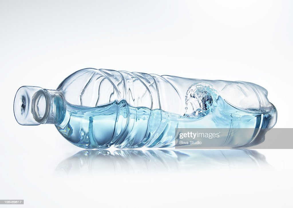 Water wave in bottle on white background