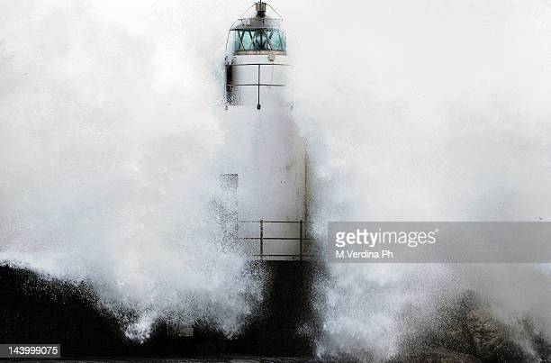Water wave on lighthouse