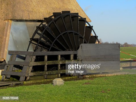 Water wheel of Dutch windmill : Stock Photo